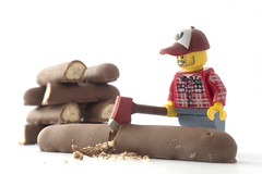 A woodsman at work (tomtommilton) Tags: stilllife food macro toy toys funny lego chocolate joke fingers humor humour biscuit axe minifig firewood lumberjack woodsman minifigure legography
