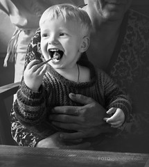 Smile (Ksana But) Tags: life family autumn winter boy portrait blackandwhite eye smile face childhood breakfast mouth children kid day child hand emotion tea teeth happiness naturallight son spoon could bnw feelings