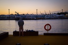 Fishing (takeaphotoitwilllastforever) Tags: sunset water outside bay fishing dock waiting industrial harbour outdoor harbourside dockside