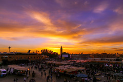 Jemaa el-Fnaa (sampollittphoto) Tags: africa travel sunset sky people orange tourism clouds square colours market outdoor dusk stall mosque morocco marrakech medina destination marrakesh jemaa djemaaelfna lakoutoubia
