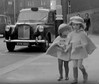 New Fashions for London Children (theirhistory) Tags: road street girls hat fashion children clothing shoes boots russia pavement cab taxi cape 1960s sovietunion ussr cccp englandlondon londoncab