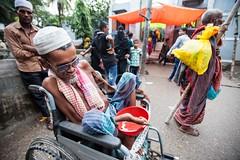 5D8_7255 (bandashing) Tags: old england man sunglasses manchester sharif shrine wheelchair disabled sylhet bangladesh beg superstitious socialdocumentary freakshow mazar dargah aoa shahjalal bandashing akhtarowaisahmed