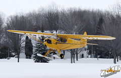2016 EAA Ski Plane Fly-in (Winglet Photography) Tags: travel winter ski cold ice wisconsin plane canon airplane flying display snowy aircraft aviation transport flight airshow transportation 7d annual icy dslr spotting eaa oshkosh stockphoto osh planespotting kosh 2016 city air water show by association event experimental wingletphotography georgewidener georgerwidener