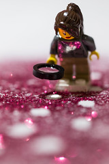 Follow the trail (DoctorTimbo) Tags: macro glitter toy found lost lego bokeh footprints follow magnifyingglass trail lostandfound clue detective macromonday