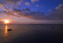 Dusk (kuytu) Tags: cruise blue light sunset sea orange cloud sun water skyline boat dusk horizon sigma down beam tropical caribbean cloudscape günbatımı güneş 1735 seascpae