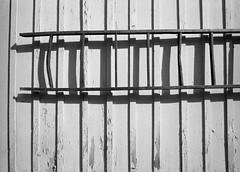 Well used (p2-r2) Tags: wood blackandwhite film station wall train nikon shadows 400 hanging ladder f3 kentmere nikkor28mmf28ais marielund