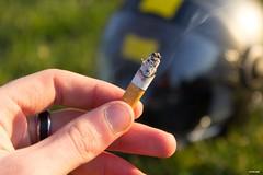 Helmet's Smoke (werewolf942) Tags: sun hand finger smoke smoking cigarettes helmets tabacco shunshine casque fume cigarettesmoke 1200d tabaccosmoke