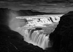 Fall of the Dark Gods (claustral) Tags: longexposure wild bw mist water monochrome river landscape waterfall iceland lowkey gullfoss