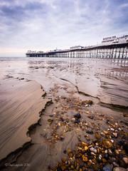 Sand on Brighton Beach (amipal) Tags: uk greatbritain sea england sky beach water clouds sussex pier seaside sand brighton europe unitedkingdom tide shingle pebbles gb lowtide southeast englishchannel palacepier