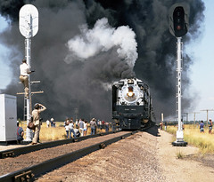 Union Pacific FEF-3 class 4-8-4 Northern steam locomotive # 8444, is seen leading a rail fan excursion train on a photo run-by in Colorado, Summer 1980 - 3 (alcomike43) Tags: old people color classic up modern vintage ties photo tracks photographers trains historic passengers negative photograph engines rails unionpacific northern spikes steamengine locomotives observers railroads onlookers ballast rightofway steamlocomotive 484 alco mainline oilburner passengertrains roadbed kersey railfans 8444 blocksignal tieplates signalcontrolbox anglebars conventionaljointedsectionrail railfanexcursiontrains fef3class