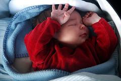 Little sleepyhead (gornabanja) Tags: sleeping red portrait baby face nikon hand d70 small daughter tiny newborn asleep