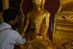 Min putting gold foil on Budha statute (Michael Chow (HK)) Tags: burma myanmar kalaw