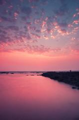 Sunset | Mumbai | Bandra bandstand #1 (singhajaydotcom) Tags: ocean longexposure sunset sea sky india seascape beach beautiful rock clouds landscape evening coast nikon sundown indian mumbai clours travesl