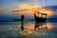 Al Ruwais-Qatar (THASLEEM MK) Tags: sunset sea reflection skyline sunrise ship horizon arab arabia arabian doha qatar