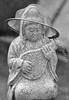 Favorite Hat (Seeing Visions) Tags: bw musician music playing texture monochrome hat statue japan metal temple kyoto stainlesssteel mesh chain jp instrument granite priest 2009 strainer fushimi fushimiinaritaisha raymondfujioka