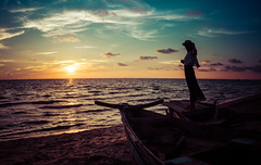 Girl On Old Boat In Vietnam (Stuck in Customs) Tags: ocean blue sunset orange white black color colour green beach water silhouette yellow horizontal night clouds outside outdoors person boat rainbow purple outdoor dusk sony horizon may vietnam nighttime gradient hdr trey southchinasea gulfofthailand 2015 ratcliff hdrphotography hdrphoto hdrtutorial p2016 treyratcliff stuckincustomscom ilce7r