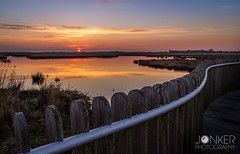 Sunset at Onlanden (melvinjonker) Tags: sunset red sky sun holland nature water colors fence reflections landscape view sundown sony colourful groningen mothernature naturephotography waterreflections naturelovers landscapephotography skyporn skylovers natureperfection onlanden landscapelovers sunsetmadness jawdroppingshots sonya58