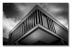 The Assembly Rooms, Derby (Descended from Ding the Devil) Tags: city sky blackandwhite bw building window monochrome architecture clouds concrete derbyshire abomination monstrosity fullframe derby carbuncle obscenity mirrorless photoborder sonya7mkii