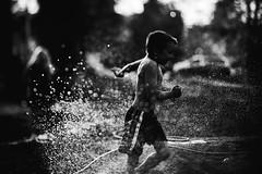 Sprinkler! dash!!!!! (privizzinis passion photography) Tags: light boy summer people blackandwhite water monochrome childhood kids children fun outdoors child play joy hose sprinkler freelensed