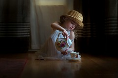 Spot of Tea (Sonya Adcock Photography) Tags: painterly girl hat painting photography child tea nikkor teacup chiaroscuro teaparty diamondclassphotographer flickrdiamond nikond700 nkin nikko105mmdc