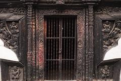 Nepal Temple Door (David L. Merin) Tags: nepal kathmandu kirtipur temple black carving wood gate metal red powder door lock travel