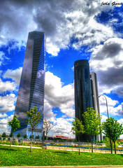 Torres (Jotha Garcia) Tags: madrid sky color colour reflection building tree tower primavera grass clouds landscape arbol spring torre crystal edificio abril paisaje cielo nubes reflejo april cristal hdr hierba 2016 huawei madriz jothagarcia