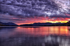 Magical Bay Sunrise (Kevin_Jeffries) Tags: morning travel light sunset red newzealand sky panorama mountain lake color reflection nature beautiful beauty sunrise wow dawn golden bay countryside nikon scenery glow superb pov scenic wideangle hills creation stunning redsky exquisite magical wanaka impressive geographic goldenhour masterpiece d90 glendhubay kevinjeffries