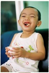 Laughing (Pankha Nikon) Tags: portrait film analog children fuji laugh fujifilm analogue filmcamera nikkormat nikkormatftn