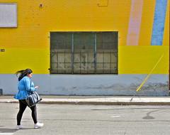 Better with Blue (Alex L'aventurier,) Tags: street city urban woman canada yellow wall jaune canon walking movement montral quebec montreal candid femme qubec rue mur fille ville mouvement urbain wlaking marcher