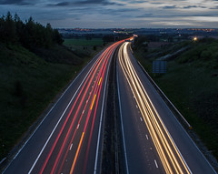 As far as the eye can see. (ian.emerson36) Tags: sky clouds lights motorway dusk vehicles lightrails