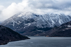 Fjord and mountains (imagesbystefan.com) Tags: ocean travel trees sea wild vacation sky mountain lake snow nature water beautiful norway clouds forest woodland landscape outdoors woods scenery europe view cloudy scenic peak scene norwegian adventure explore valley summit fjord wilderness scandinavia range slope