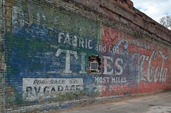 Fabric and Cord Tires (dangr.dave) Tags: architecture downtown texas tx coke historic tires cocacola ghostsign