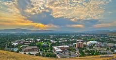 University of Montana (kevin-palmer) Tags: school autumn sunset panorama fall clouds campus evening montana view stitch scenic september missoula rays smoky hazy crepuscular universityofmontana mtrail 2013 pentaxk5 samyang14mmf28