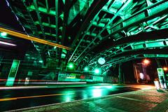 green machine (Blende57) Tags: lighting street longexposure light motion blur reflection art wet night underpass wideangle busstop lighttrails bochum railroadunderpass