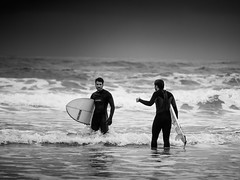 ... surfers on the storm ... ( ... on Rodiles's Beach ... ) (Fede Falces ( ...... )) Tags: sea blackandwhite bw storm beach dark eyecontact surf waves dof noiretblanc candid depthoffield