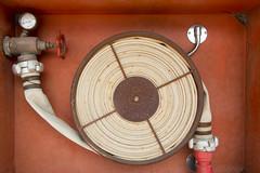 Fire hose (Jan van der Wolf) Tags: orange composition circle hose round meter firehose roest slang cirkel rond brandslang roestig map150448v