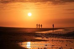 Penny For Them. (www.kompleatphotography.com) Tags: ireland light sunset sunlight art beach silhouette dusk shore orangesky northernireland photoart giantscauseway portrush photooftheday whiterocksbeach