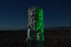 foo dog (green). mojave desert, ca. 2014. (eyetwist) Tags: california longexposure dog lightpainting west green statue night america dark landscape photography star route66 nikon desert random fierce tripod guard chinese lion trails statues 66 fullmoon route american highdesert mojave foo jaws americana moonlight marble roadside nikkor shi gel nocturne feng claws guardian liondog startrails mojavedesert amboy middleofnowhere mythical fudog shui foodog  guardianlion fulion eyetwist npy d7000 capturenx2 eyetwistkevinballuff nikond7000 1024mmf3545g americantypology