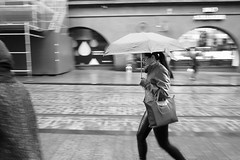 Umbrella series (HKI DRFTR) Tags: life street urban blackandwhite girl monochrome rain weather contrast umbrella finland helsinki scenery europe candid snapshot streetphotography saturday motionblur everyday tones grumpy citycentre greys
