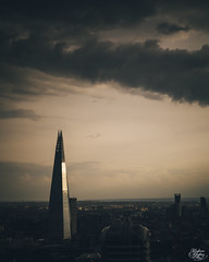 Shard (Umbreen Hafeez) Tags: city uk light sunset england building london skyline architecture clouds skyscraper buildings europe long exposure moody cityscape cloudy low gb shard