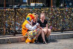 Selfie with a Clown (Serendigity) Tags: city paris france sunshine sunglasses smiling women sandals clown railings padlocks selfie lovelocks selfiestick