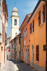 Sogliano al Rubicone - Street and belfry (clodio61) Tags: street old blue sky italy house building tower church lamp vertical architecture town streetlight europe day clr landmark nb belfry curve westerneurope clearsky emiliaromagna py od cesena forli urbanscene italianculture europeanculture sogliano