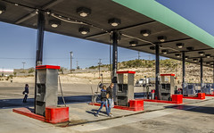 Somewhere in the USA (Preston Ashton) Tags: people usa sun sunshine station america day sunny northamerica filling
