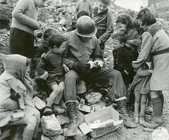 An American soldier sharing his Christmas package with children somewhere in Italy, 1940s [500 X 415] #HistoryPorn #history #retro http://ift.tt/1rhD8Ot (Histolines) Tags: christmas italy history children soldier with x an retro 1940s american sharing his timeline 500 package somewhere 415 vinatage historyporn histolines httpifttt1rhd8ot