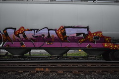 NOBLE (TheGraffitiHunters) Tags: street pink red orange white black art yellow train graffiti colorful paint purple tracks spray hopper freight benched benching