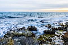 Resaca ([Nelooo]) Tags: atardecer playa olas rocas larga castelln exposicin benicssim reneg