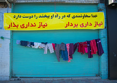 wall of kindness to give clothes for free to poor people, Central County, Yazd, Iran (Eric Lafforgue) Tags: poverty street charity horizontal outdoors asia iran muslim homeless poor persia social nobody clothes help solidarity dailylife textiles yazd    iro  centralcounty colourpicture  irandsc08136