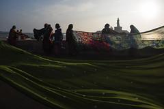 Women at Kanyakumari (Ravikanth K) Tags: street morning shadow sea people green beach water statue rock women bath memorial waves outdoor dry clothes southern tip cape layers saree kanyakumari thiruvalluvar vivekananda kanniyakumari comorin 500px nikond750