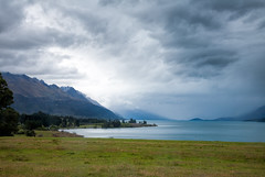 Stormy sky over Lake Wakatipu in New Zealand (Dmitri Naumov) Tags: newzealand summer sky lake nature rain weather horizontal landscape outdoors photography pond cloudy dusk dramatic atmosphere nobody nopeople shore lakeshore otago environment remote wilderness wakatipu ambience climate cloudscape waterside scenics distant 2010 waterscape mountainrange traveldestinations colorimage beautyinnature nonurban southislandnewzealand tropicalclimate