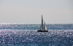 The shimmering sea (Ziad Hunesh) Tags: blue sea sun sunlight water silhouette canon boat sunny tamron shimmering glistening 650d zhunesh 16300mm